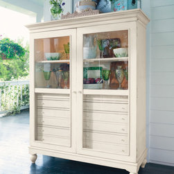 Universal Furniture - Paula Deen The Bag Lady's Cabinet in Linen - The Bag Lady's Cabinet from Universal Furniture's Paula Deen Home Collection provides stylish storage. The Bag Lady was the name of Paula's first business venture that involved making bag lunches for local business people in the Savannah area. Paula herself has said she likes cabinets that allow you to show off your pretty things and hide stuff that isn't so pretty.  The Bag Lady's Cabinet has glass doors behind which you'll find display area up top and storage area below. Pretty AND convenient!