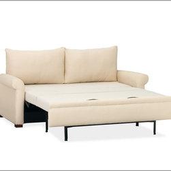 PB Deluxe Sleeper Sofa - I love how this sleeper sofa from Pottery Barn looks exactly like a proper bed.