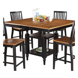 """Steve Silver Furniture - Steve Silver Candice Square Counter Table in Oak and Black - The Candice collection offers country-style simplicity, transforming any dining area into a charming sanctuary. The black and oak Candice counter table features a 12"""" butterfly leaf and is supported by a square base with shelves for storage or display. The table measures 54""""W x 42""""L without the leaf and 54""""W x 54""""L with the leaf in place. Add the Candice black and oak counter chairs and you can comfortably seat eight!"""