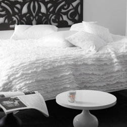 ribbon quilt - white - Add a layer of frilly texture that's also contemporary with this white ribbon quilt. It's pure soft serene luxury. Just don't drink your coffee anywhere near it!