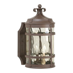 Exteriors - Exteriors Espana Traditional Outdoor Wall Sconce - Medium X-19-4105Z - This Medium-sized Craftmade Espana Traditional Outdoor Wall Sconce is a piece with a little bit of flair and a lot of style. You can't help but notice the design of the frame in an rustic iron finish and hammered champagne glass diffuser. It has a traditional Spanish design that will complement a wide range of architectural styles.