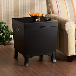Southern Enterprises - Southern Enterprises Forney End Table Trunk - Black - HN1691-0 - Shop for Tables from Hayneedle.com! Don t just pile throws and books beside the sofa - tuck them into the Southern Enterprises Forney End Table Trunk - Black. And then of course top the table with a cup of coffee or a cocktail. Crafted with durable MDF hardwoods and birch veneer this transitional piece doubles as an end table and storage chest. The flat top lifts to an open compartment for blankets books and more. A deep black finish silver door knocker-style handles and simple pedestal feet are tailored touches. About SEI (Southern Enterprises Inc.)This item is manufactured by Southern Enterprises or SEI. Southern Enterprises is a wholesale furniture accessory import company based in Dallas Texas. Founded in 1976 SEI offers innovative designs exceptional customer service and fast shipping from its main Dallas location. It provides quality products ranging from dinettes to home office and more. SEI is constantly evolving processes to ensure that you receive top-quality furniture with easy-to-follow instruction sheets. SEI stands behind its products and service with utmost confidence.
