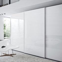 "Custom Made Closets with Sliding Doors - Contemporary closet with ""Crystal"" sliding doors, from Novamobili."