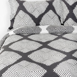 Magical Thinking Diamond Tile Duvet Cover, Dark Gray - I love the graphic, tribal feel of this bedding from Urban Outfitters. It's great for your worldly bedroom.