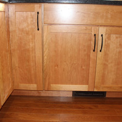 Kitchen Remodel, Wooster, OH #1 - This kitchen was updated using Medallion Silverline Cherry cabinets in the Lancaster Door style in natural stain accented with Top Knobs Newport Pulls in Flat Black .   Crown molding was added to the cabinetry in black cherry onyx accents with a Roman arch valance.  Clear glass inserts and finished interiors were installed in the cabinets left and right of the window.  Angola Black Granite was installed on the countertop and Colorado Bluff Tile accented with Silver Aspen Blend 2x2 inserts were installed in a pinwheel design for the backsplash. Also installed was an Artisan single bowl 16 gauge stainless steel undermount sink and Artisan faucet in Satin Nickel.  Hartland Series, Sienna Oak wood was installed on the floor.