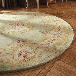 Frontgate - Monceau Area Rug - A lyrical botanical border surrounds our hand-tufted Monceau Area Rug to provide rich texture and softness. Beautifully crafted with impeccable attention to detail, these densely woven rugs add warmth and old world sophistication to any room, including high traffic areas. 100% pure virgin, hand-spun wool . Hand-tufted construction . Wool rugs are extremely durable. Safavieh rugs are easy to care for. Depending on the size, slight variations in the border design may occur in these individually crafted area rugs.  Made in India.