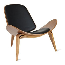 "Carl Hansen and Son - Shell Chair | Design Within Reach - Danish designer Hans J. Wegner preferred to work in solid wood, but occasionally he explored the use of bent plywood, and for that we are very thankful. Sometimes called the ""smiling chair,"" his Shell Chair (1963)achieves a floating lightness due to its wing-like seat and the arching curves of its tapered legs. And while it stands on only three legs, this chair has an absolute stability that could only be achieved by someone with Wegner's expertise in cabinetmaking and architecture. Wegner's belief that a chair ""should be beautiful from all sides and angles"" is especially evident with his Shell Chair. This comfortable masterpiece is a marvel of grace and beauty. Made in Denmark."