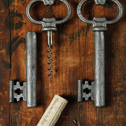 Skeleton Key Bottle Opener & Cork Pull - Antique Silver - This fresh collector's favorite brings the romance and simplicity of the classic key motif, which forms a complex yet homelike mood in your decor, to a practical item you'll always want close to hand.� The Skeleton Key Bottle Opener and Cork Pull integrates a hidden corkscrew into its shaft, though its teeth cover the sharp implement so you can reach without looking; the loop pops up metal caps with ease.