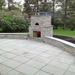 Outdoor Fondulac Stone Fireplace and pizza oven - This is an outdoor stone fireplace and Pizza oven built with a unique over/under design. In St. Louis Park, MN