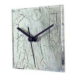 River City Clocks - River City Cracked Glass Design Square White Glass Wall Clock - This glass wall clock is white with black lines which resemble a cracked surface. The glass is hand-made by artisan glass designers in Hungary. The glass is complimented by a set of silver hands that are powered by an accurate and reliable German-made quartz movement.