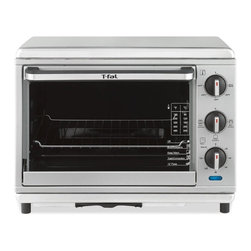 T-fal - T-fal OT274E51 Toaster Oven with Convection & Rotisserie Multicolor - 0109422144 - Shop for Rotisseries from Hayneedle.com! The T-fal OT274E51 Toaster Oven with Convection & Rotisserie does it all with its toast bake and broil functions. Pumping out 1800-watts with ease this toaster oven has an adjustable temperature setting up to 450 degrees. The stainless steel tray removes with ease for convenient cleaning.About T-fal:Where would we be without the nonstick frying pan? In the dark ages of cookware but thanks to T-fal's ingenious invention in the 1950s we're well-equipped and up to speed. Headquartered in West Orange NJ T-fal has continued to introduce an impressive range of cookware collections featuring nonstick coatings and made for use with metal utensils. Known for the quality engineering and distinct designs of their products T-fal's expansive product line includes toasters indoor grills electric kettles blenders rice cookers and more. Quick to meet the needs of customers T-fal prides itself on consumer loyalty and satisfaction.
