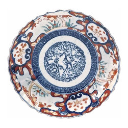 Porcelain Imari Plate - Antique porcelain Imari plate, featuring a central blue and white stylized flamingo bird in a garden and additional painted multicolored floral and patterned accent design around perimeter. Back of plate has blue and white floral accents.