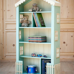 Cottage Dollhouse Tall Bookcase - Recalling the timeless imaginations of little girls, we offer the adorable Tall Cottage Dollhouse Bookcase for hours of creative play. This artfully designed cottage with scalloped roof, chimney, cut-out windows, picket fence and planked background is over 6 feet high and lends a vintage touch to a bedroom. It is sure to be a treasured heirloom for years to come. Bookcase can be ordered as: All solid color; OR Main color applied to house walls and interior shelves with a contrast color applied to roof, windows, fence and back slats. Shown in Ocean Aqua with Antique Cream and White Linen with Vintage Pink and Custom Colors. Our Cottage Collection offers painted furnishings that are designed to look as though they have been around for years – distressed, worn and antiqued with a warm, rich and weathered feel. Each furniture piece is crafted and finished by hand using Sugar Pine Wood that reflect hours of hand rubbing and is sealed and protected with clear, flat lacquer. All pieces are made in the U.S.A. using Solid Wood Only including the bottom of every drawer to the back slats on all pieces.