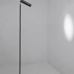 """Catellani & Smith - Lucenera 506 floor lamp - Product description:  The series 500 is the high-tech version in the Lucenera line. The use of low voltage 12 V - 50W bulbs with a 10° dish and the possibility to increase or decrease the volume of the light beam make this a highly practical work tool for lighting professionals. Its simplicity and versatility make it the ideal system for lighting display areas, exhibitions, shops, restaurants and bars. Magical in both domestic and work environments.  The Lucenera 506 floor lamp features a black, unidirectional fibre tube with high heat resistance. The base consists of rubber black painted steel with a black Dekabon tube and shiny nickel brass details. You can switch between two light intensities. Available with a toroidal 50W transformer or an electronic 60W dimmer. NEW LED version available.      Details:                                Manufacturer:                             Catellani & Smith                                                Designer:                             Enzo Catellani                                                Made in:              Italy                                  Dimensions:                             base: 8.27"""" x 8.27"""" (21 x 21cm); diffuser tube: d: 2.2"""" (5.6 cm) x lenght: 9.45"""" (24 cm); height: 62.99"""" (160 cm)                                                Light bulb:                            1 x 50W 12V GU5.3 10° light bulb (included) or 1 x 4W GU10 LED                                                Material:               carbon, steel, Dekabon                      Manufacturer:   Carlo Catellani & Logan Smith:   Carlo Catellani was born in Parma in 1960. After leaving school, he started a career as a smith in a workshop in Fornovo. Logan Smith, born in London in 1931, graduated in architecture from Cambridge and soon, due to his love to the world of horses, specialised in the renovation of race tracks and horse clubs. Then the two met in Minorca in the summer of 1985 to a big"""