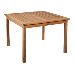 SEI - Square Dining Table - Light Brown - This stylish square dining table provides a modern presence and a sturdy design. This is an elegant addition to any outdoor living space or sunroom. In the center of the table is a space large enough for any standard umbrella to provide shade during warm summer days. The table features four sturdy legs and a wooden slat top to allow for quick drying after rainfall.
