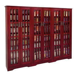 Leslie Dame - Six-Door Mission Media Cabinet w Fretted Glas - Color/Finish: Dark Cherry. Have fully adjustable shelves allowing for storage of DVD's, CD's, Videocassettes, and Game Cartridges. Holds 1431 CD's, 666 DVD's, 360 VHS Videocassettes. Including hand-rubbed Oak Veneer, Tempered Glass and Antique finished Metal door pulls. Some assembly required. Overall dimensions: 74 in. W x 9 1/2 in. D x 61 3/4 in. HMultimedia Storage Cabinets has the rare combination of timeless design and high quality construction