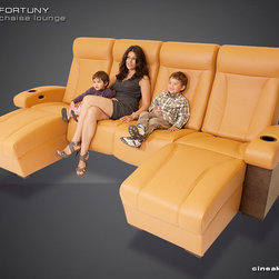CINEAK Fortuny Luxury Home Theater Seats - The FORTUNY theater chair was created for the most luxurious home theater. It's concept is unique in many aspects and the design combines leather upholstery, varying stitching finishes, ergonomic contours, real wood veneer and an independently controlled reclining and inclining mechanism. The chair was designed by the Mitra Theaters team as a seating solution for their exclusive high-end home theater projects.