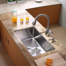 Kraus - Kraus KHU100-30-KPF2120-SD20 Single Basin Undermount Kitchen Sink with Faucet Mu - Shop for Kitchen from Hayneedle.com! With the Kraus KHU100-30-KPF2120-SD20 Single Basin Undermount Kitchen Sink with Faucet installed in your kitchen things will be running smoother than ever. The arching faucet doubles as a strong sprayer while an integrated dispenser has your choice of soap right in reach. The oversized basin is made from stainless steel to last while the satin finish hides scratching.Product SpecificationsBowl Depth (inches): 10Weight (pounds): 31Low Lead Compliant: YesEco Friendly: YesMade in the USA: YesHandle Style: LeverValve Type: Ceramic DiscFlow Rate (GPM): 2.2Spout Height (inches): 8Spout Reach (inches): 10About KrausWhen you shop Kraus you'll find a unique selection of designer pieces including vessel sinks and faucet combinations. Kraus incorporates its distinguished style with superior functionality and affordability while maintaining highest standards of quality in its vast product line. The designers at Kraus are continuously researching and exploring broader markets seeking new trends and styles. Additionally durability and reliability are vital components at Kraus for developing high-quality fixtures. Every model undergoes rigorous testing and inspection prior to distribution with customer satisfaction in mind. Step into the Kraus world of plumbing perfection. With supreme quality and unique designs you will reinvent how you see your bathroom decor. Let your imagination become reality!