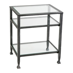 "Holly & Martin - Holly & Martin Guthrie Metal End Table - Create an elegant atmosphere in your home with this sleek contemporary end table. The solid metal frame is constructed of square tube with flared feet. This end table is 24"" tall, has one shelf that sits 6"" above the ground and one that is recessed approximately 6"" below the top creating a shadowbox effect that is perfect for books, potpourri, or collectables. The top and two lower shelves are inset with solid pieces of tempered glass while the frame is finished with brushed black paint. Use this contemporary end table to accent the decor in your home."