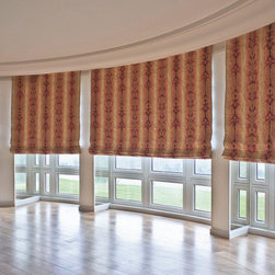 Curved Wall Motorized Roman Shades - Curved and motorized flat roman shades with motorized roller screen shades behind. Custom made.