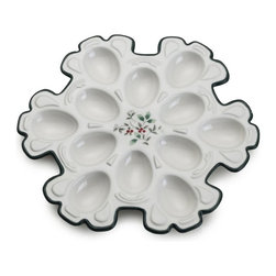 Pfaltzgraff - Pfaltzgraff Winterberry Snowflake Egg Tray Multicolor - 5112028 - Shop for Trays from Hayneedle.com! A one-trick pony? Nope! You can do so much more than deviled eggs with the Pfaltzgraff Winterberry Snowflake Egg Tray. Serve chocolates rum balls clementines and more for a festive wintry presentation that carries you from Thanksgiving through New Years' and beyond. Crafted of hard dolomite earthenware this sculpted piece features dark forest green edging and a delicate holly motif at the center. It's the perfect gift for a thoughtful hostess.About PfaltzgraffWhen the name Pfaltzgraff is spoken people think of fine ceramics for the home and beautiful dinnerware for their table. For nearly 200 years the Pfaltzgraff brand has been associated with the highest quality of ceramic products. The company has grown from a little pottery shop that produced simple earthenware salt-glazed stoneware crocks and even flower pots into one of the most beloved designers and marketers of dinnerware drinkware ceramic accessories giftware and other products.
