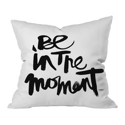 "DENY Designs - Kal Barteski 'Be in the Moment' Throw Pillow - There you are, rushing through your typical busy day, when a black and white throw pillow catches your eye. There, hand-scripted like a note to self, is a simple, eloquent reminder to ""be in the moment."" The graceful strokes of the Asian ink brush infuse a Zen silence into the message, and you stop to take a breath in gratitude. For a break in your personal contemporary chaos, toss this pillow into the mix."