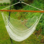 """Algoma Net Company, Div. of Gleason Co - Hanging Nylon Net Chair - Sweet spot to study! Or just relax. This woven nylon net hammock chair has a wood spreader bar that spans 47"""" creating a comfortable nesting place. Hammock swing hangs from trees, porches, patios or with Algoma's hanging chair stand, model 4750BR (sold separately)."""