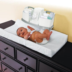 Babys Journey - Babys Journey Always Ready Changing Station Multicolor - 2010 - Shop for Changing Tables from Hayneedle.com! The Babys Journey Always Ready Changing Station is like having a well stocked pit crew that's ready to change your baby anytime anywhere. This essential setup includes a contoured changing pad with an organizer that holds wipes diapers and all those other must-have items. There's even a motion-activated night light that's ready for those late night accidents. The pad and organizer are designed to fit standard dresser tops and changing tables.About Baby's JourneyThe Baby's Journey team has a diverse background that includes a designer from Hasbro's G.I. Joe line and a board of directors with a combined total of over 20 000 changed diapers. They know what parents need because they're all parents who've needed the kind of products that Baby's Journey delivers every day. By using innovative processes and a bit of creativity in everything they do Baby's Journey produces unique and effective everday items like changing pads bathing accessories and travel items that make life with a new baby as enjoyable as it ought to be.