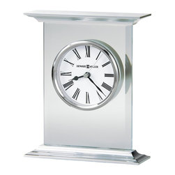Howard Miller - Clifton Table Top Clock w Carriage-Style Alum - Glass and metal carriage tabletop clock; 3/8 in. thick glass panel has beveled sides and polished edges. Brushed aluminum top and base have polished profiled edges. Dial offers a white background with black Roman numerals beneath glass and a polished chrome finished bezel. Both the hour and minute hands are black, while the seconds hand is silver. Features a felt covered bottom to protect your desk or tabletop. Quartz movement includes the battery. 5 3/4 in. W x 1 3/4 in. D x 7 in. H