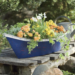Handmade Recycled Metal Boat Planter/Container - No garden is complete without some creative potting solutions. They work wonders for your favorite potted plants or even as a drink container for an outdoor party. We love the nautical appeal of this one.