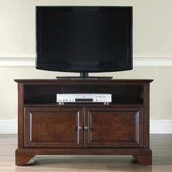 """Crosley - LaFayette 42"""" TV Stand - Enhance your living space with one of Crosley's impeccably-crafted TV stands. This signature cabinet accommodates most 42'' flat panel TVs and is handsomely proportioned featuring character-rich details sure to impress. Raised panel doors strategically conceal stacks of CDs/DVDs, gaming components and various media paraphernalia. Open storage area generously houses media players and the like. Adjustable shelving offers an abundance of versatility to effortlessly organize by design, while cord management systems tame the unsightly mess of tangled wires. Customize our distinct cabinets by selecting one of four collection styles (featuring tapered, traditional. turned or bun feet) in your choice of one of three signature Crosley finishes. This customizable cabinet approach is designed for easy assembly, built to ship and constructed to last. Features: -Raised panel doors.-Adjustable shelf for storing electronic components, gaming consoles, DVDs and other items.-Adjustable levelers in legs.-Recommended TV Type: Flat screen.-TV Size Accommodated: 42"""".-Powder Coated Finish: No.-Gloss Finish: No.-Material: Hardwood and veneers.-Solid Wood Construction: No.-Distressed: No.-Exterior Shelves: Yes -Number of Exterior Shelves: 1.-Adjustable Exterior Shelves: No..-Drawers: No .-Cabinets: Yes -Number of Cabinets: 1.-Number of Doors: 2.-Door Attachment Detail: Pin hinge.-Interchangeable Panels: No.-Magnetic Door Catches: Yes.-Cabinet Handle Design: Knob.-Number of Interior Shelves: 1.-Adjustable Interior Shelves: Yes..-Scratch Resistant : No.-Removable Back Panel: No.-Hardware Finish (Finish: Black): Brushed nickel knobs, steel hardware.-Hardware Finish (Finish: Classic Cherry, Vintage Mahogany): Antique brass knobs, steel hardware.-Casters: No .-Accommodates Fireplace: No.-Fireplace Included: No .-Lighted: No .-Media Player Storage: Yes.-Media Storage: No .-Cable Management: Hole in back for wires.-Remote Control Included: No.-Batteries Required"""