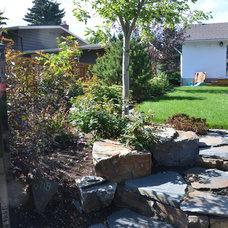 Transitional Landscape by Prairie Outpost Garden Design INC.
