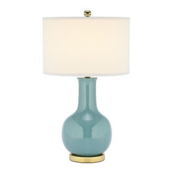 Safavieh - Indoor 1-light Louvre Light Blue Table Lamp - The Louvre lamp is sure to brighten up any decor. It features an off-white linen shade and a light blue glazed ceramic body. The smooth curves and flawless architecture of the lamp is reminiscent of Eiffel Tower.