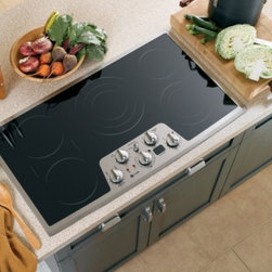 "GE Profile - CleanDesign PP962SMSS 36"" Smoothtop Electric Cooktop with 5 Ribbon Elements  Bri - Other ways GE Profile and GE make cooking a pleasure include adjustable heating elements that match the heated area to the size of the pan ranging from 12 inches down to five inches The cooktops have the capability to lock the controls helping protec..."