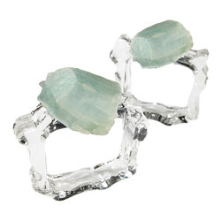 Ardana Napkin Rings - Aquamarine - Icy seafoam coloring naturally sets apart aquamarine gemstone, and this hue is beautifully displayed in the Ardana Napkin Rings' toppers of uncut crystal, each hand-polished but left with its natural edges and forms for a transitional take on the jeweled napkin ring.  Not to be outdone, the ring itself is perfectly pellucid glass, hand-shaped to give a geometric yet organic effect with a glitter that looks luscious on your table.