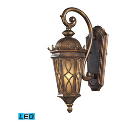 Elk Lighting - Burlington Junction LED 1-Light Outdoor Sconce in Hazelnut Bronze - Located on the eastern shore of lake champlain between the adirondack and green mountains, burlington is charming and idyllic. This series was inspired by this quaint city by the lake that prides itself in the arts. The fine craftsmanship of this collection is evident in the cast aluminum details and scrollwork. This series is available with two glass options; a clear seeded glass or amber scavo glass. - LED offering up to 800 lumens (60 watt equivalent) with full range dimming. Includes an easily replaceable LED bulb (120V).