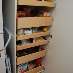 Cabinet Pantries - When your pantry shelves are well-stocked it can be difficult to see the items in the back of the shelf...unless you have full-extension pull out pantry shelves from ShelfGenie.  Better access, increased visibility and great organization for any room in your home!