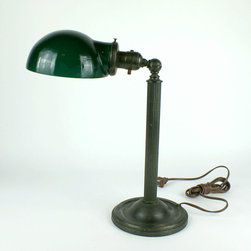 """Brass Lamp with Emeralite Shade - Unusual Emeralite style cased glass green shade on a desk or piano lamp that dates to around 1915. The adjustable brass lamp has nice detailing and a wonderful rich patina. It has also been recently rewired and it measures 14 1/2"""" tall as shown in first photo. The base is 6"""" in dia. and the shade is also 6"""" in dia. Click on images to enlarge. (This lamp is sold.) We have many industrial brass lamps in stock. Just ask for photos."""