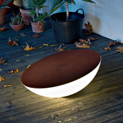Foscarini - Solar Outdoor Floor Fixture - Solar is a new type of object, a contemporary hearth around which to gather and chat, at home or outside. Available in an indoor or outdoor version. Features white diffuser with a dark wood top. The hemispherical body, made of polyethylene, is stable even when it is tilted by 15 degrees. The angling determines the quantity of light diffused, allowing multiple effects and atmospheres to be created. One 25 watt, 120 volt, T3 coil medium base compact fluorescent lamp not included. General light distribution. 31.25 inch diameter x 14.88 inch height.