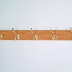 5-Hook Wooden Wall Coat Rack - Offer your guests a convenient and prominent place to hang their coat when they enter your home or office. The Five-Hook Coat Rack is a simple functional coat rack crafted from 3/4-inch solid red oak wood. Five double hooks provide ample space for coats hats dog leashes and umbrellas. This wide coat rack is available in your choice of brass or nickel hooks and three attractive wood finishes to complement any decor style. About Wooden MalletFor over 20 years Wooden Mallet has been turning Northern Red Oak into beautiful and functional American-made wood products for commercial and residential settings. Wooden Mallet manufactures and distributes various styles of magazine and brochure display racks chart holders luggage racks coat and hat racks and reception chairs and tables crafted from solid oak sides and components. In addition to a technological manufacturing process Wooden Mallet also employs a unique finishing process using ultraviolet light to cure the finish into the wood for a more durable lasting finish. This process meets the emission standards set by the Environment Protection Agency. For the past 10 years Wooden Mallet has ranked consistently in the top 100 of the Wood & Wood Products Wood 100 Annual Report for Solid Wood and Panel Technology.
