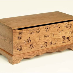 Fifthroom - Engraved Toy Oak Chest - Our delightful Engraved Toy Chest is crafted in a style that is reminiscent of the 40's and 50's.  Sturdily constructed from 100% solid Oak, it also possesses the strength and durability to withstand years of heavy use.  Available in a choice attractive wood stains, it's finished with two coats of lacquer.  For extra protection, this toy chest also features pinch-free front panels & counter-balanced lid supports.