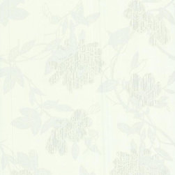 Graham and Brown - Steve Leung Jiao Wallpaper - Not your ordinary wallflower. This pretty paper in white offers a serenely beautiful and contemporary take on a climbing floral vine. It'll add subtle sheen to your interiors with metallic flecks that give it a three-dimensional effect.