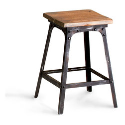 Redmond Stool - A striking blend of raw iron and natural wood imparts an air of rustic refinement to the Redmond Stool. With a whisper of the industrial in its forged detailing, the stool is versatile enough for placement within a sleek urban loft, a carriage house, an eclectic great room, or a summerhouse in the country.