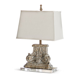 Kathy Kuo Home - Rivier French Country Capitol Pillar Table Lamp - An eclectic combination of clear crystal and weathered architectural artifact, this table lamp complements any décor. Floral relief sculptures grace the base of the lamp, while a crisp, white rectangular shade crowns the creation.