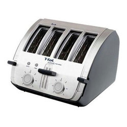 "T-Fal/Wearever - T-Fal Avante 4 Slice Deluxe Toaster - T-fal Avante Deluxe 4-Slice Toaster with black and chrome finish. The sleek, angled design is ideal for the simple removal of your toast. 4 slots with 2 independent controls; 1800 watts; 7 browning levels; Extra wide slots work - for a wide range of bread and bagels; Removable crumb tray - for easy cleaning; Measures approx. 13""H x 14""W x 12""deep; Weighs approx. 9-1/2 lbs.; Made in USA. TT750150"