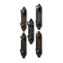 Hooks With Animal Heads - Go ahead and hang your coat on your choice of animal head. These antiqued nickel animal hooks would offer a pop of fun to the mudroom.