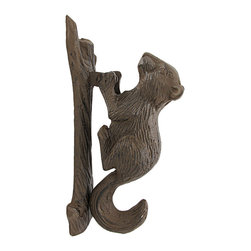 Zeckos - Rustic Cast Iron Squirrel Door Knocker Nature - This beautiful cast iron 3 dimensional squirrel door knocker is an excellent addition to the front doors of nature lovers. It is finished with a brown enamel that mimics rust, and gives the knocker an aged look. The knocker measures 7 inches tall, 2 1/2 inches wide, 3 1/2 inches thick, and has 2 screw holes in the branch-shaped mounting plate for mounting to your door. It has wonderful detail and the aged finish looks great on any color door. The mount doubles as a striker protector, so it won't mar your door.
