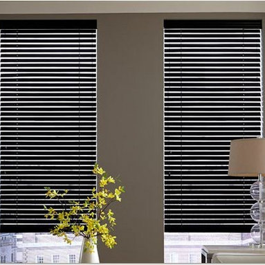 Wood Blinds- 3 Day Blinds- Living Room - Wood Blinds from 3 Day Blinds come in a variety of wood blends and solid tones. These black wood blinds create a modern and sleek look in this living room. Select from multiple valances made from the material as the blind to create a seamless look.