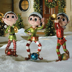Frontgate - Set of Three Pixie Elves - Outdoor Christmas Decorations - Crafted of nonfading, hand-painted resin. Sit just as easily in a snow-filled lawn as they will on the front porch. Whimsical addition to your outdoor display. Decorate your walkway with a parade of melodious Pixie Elves – each with their own musical instrument in hand. Their pointed ears, rosy cheeks, wide-eyed expressions endear them to passersby.. .