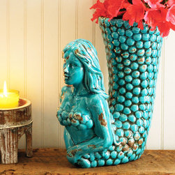 Sea Belle Vase - Dive in and double your color injection by filling this turquoise-toned beauty with the blooms of your choice. In the meantime, her smooth ceramic form is a cheeky but sophisticated addition to the living room or entry.